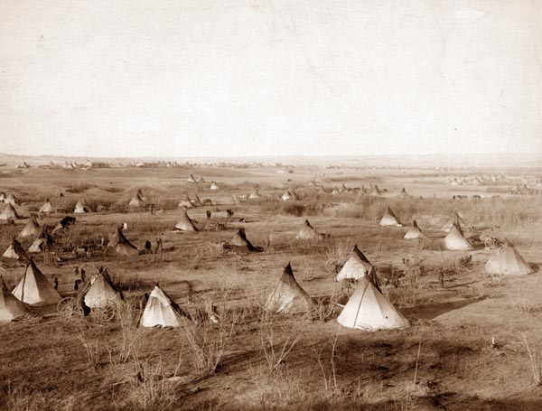 A Sioux village in the Pine Ridge Indian reservation.  Taken in 1891.